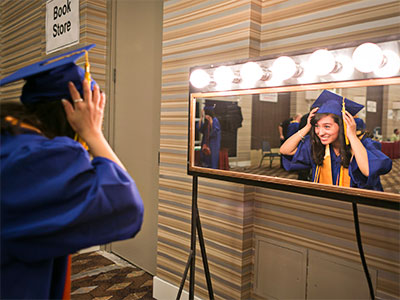 Grad Looking in the Mirror