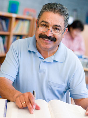 Man With Book Smiling Image