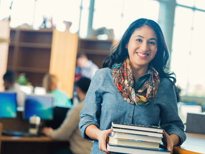 Woman Student With Books Image