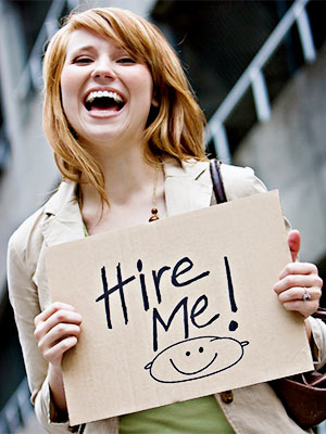 Woman with Hire Me Placard