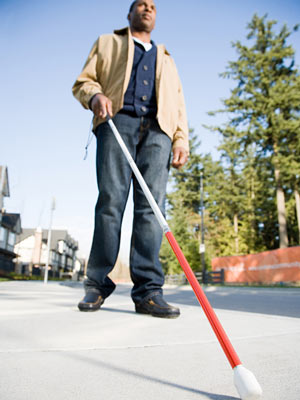 Man Walking with Cane Photo