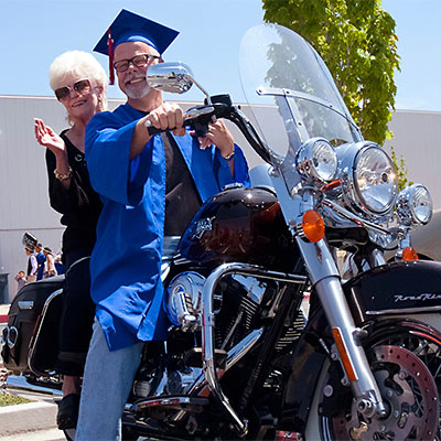 Graduate on Motorcycle
