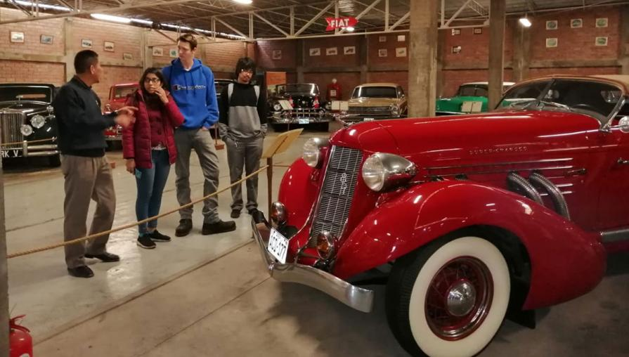 Students in automobile museum.