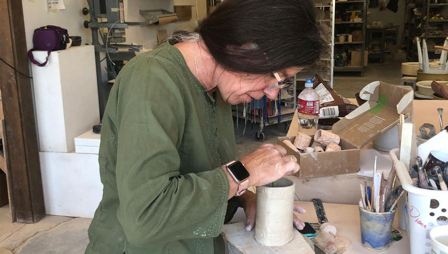 Diana Keef-Adams at work on a ceramic project.