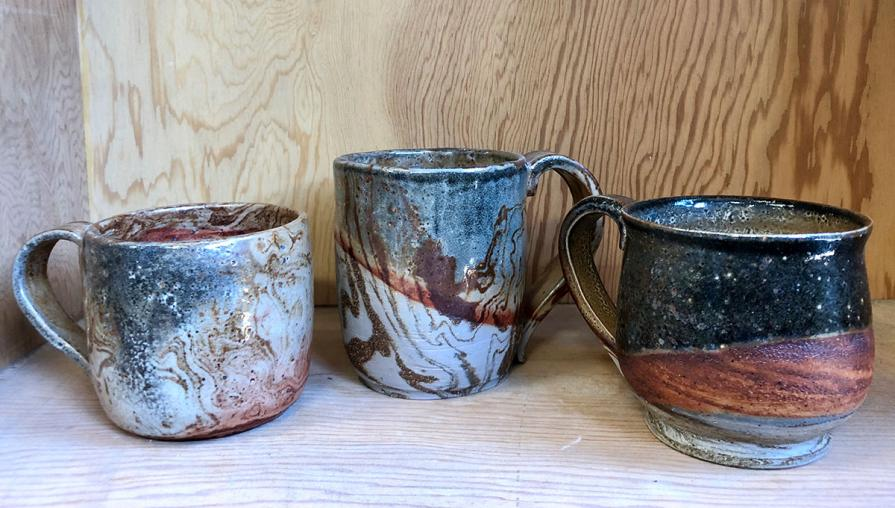 Three ceramic mugs.