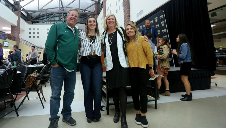 Samantha Lampe and her parents with Tina Ruff.