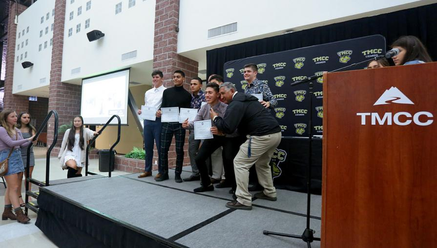 Members of the men's soccer team with Coach Gonzalo Lopez.
