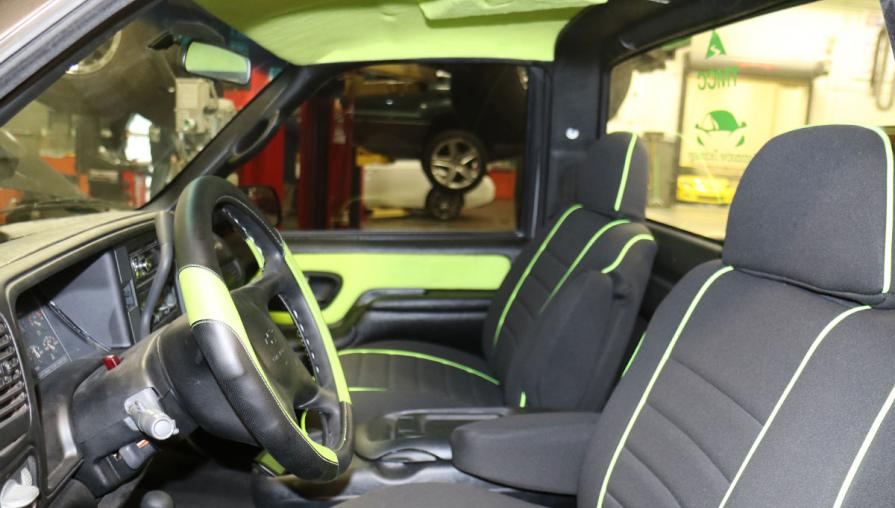 Interior of the truck cab, decorated in black and green.