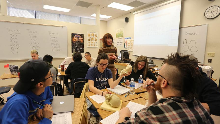 Namie working with students in a classroom