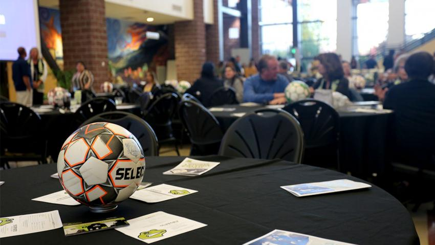 Soccer ball at the center of a banquet table.