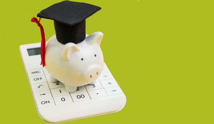 Image of a piggy bank wearing a graduation cap.