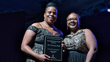 Dr. Precious Hall receiving an award