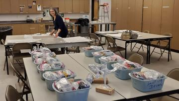 Art instructor Rossi Todorova assembles kits in the drawing studio.