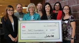 TMCC Foundation members with an oversized check from CREW.