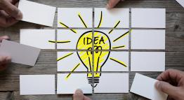 Several small pictures coming together to make the image of a light bulb.