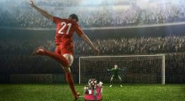 Artwork depicting a soccer player kicking a gift into a goal.