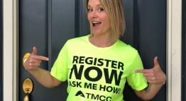 A woman wearing a t-shirt that says Register Now, Ask Me How.